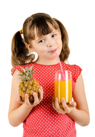 citrous: beauty little girl, hold pineapple and  drink  juice, on white background, isolated Stock Photo