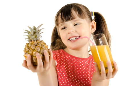 citrous: happy beauty little girl, hold glass with pineapple juice and smile, on white background, isolated