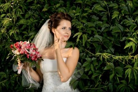 fiancee: horizontal wedding portrait beautifull  fiancee in white dress with wedding veil, on nature