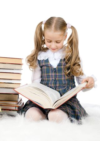 girl sit: the cute little teen girl sit,  read big textbook, on white background, isolated