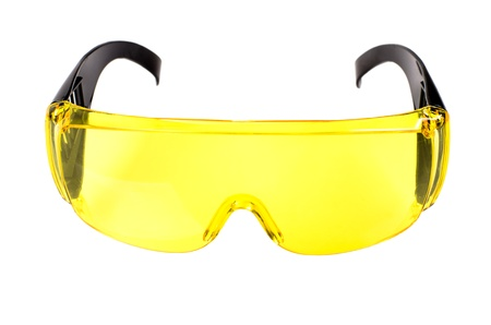 eye protectors: yellow protective spectacles on white background isolated, close up full face