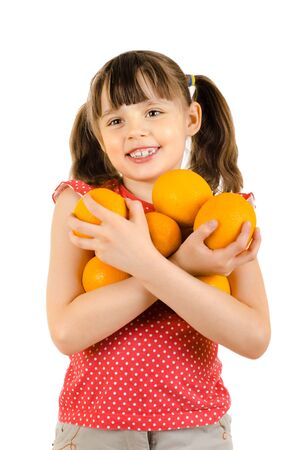 happy beauty little girl, hold many orange and smile, on white background, isolated photo