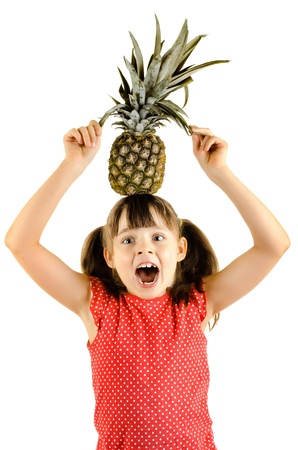happy beauty little girl, hold pineapple and smile, on white background, isolated Stock Photo - 15201701