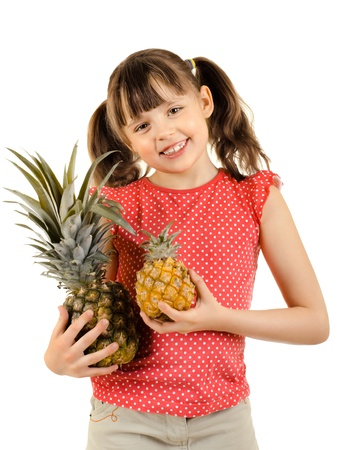 beauty little girl, hold two pineapple , on white background, isolated Stock Photo - 15201707