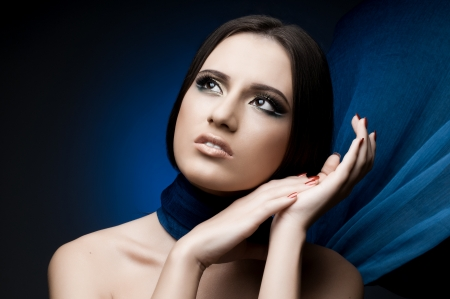 the very  pretty woman with  blue  neckerchief, sensual sexuality gaze photo