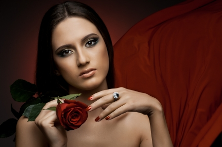 the very  pretty woman with red  rose, sensual sexuality gaze photo