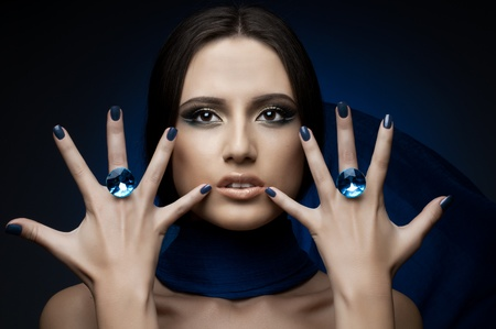 the very  pretty woman,  rings with huge blue brilliant, sensual sexuality gaze photo