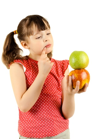 ruminate: beauty little girl, hold apple and  deep in thought, on white background, isolated Stock Photo