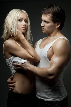 muscular handsome sexy guy with pretty woman, on dark background, glamour  light Stock Photo - 14995241