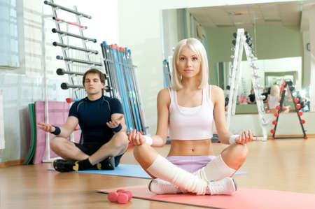 cutie: happy cutie athletic girl and guy,  execute exercise , in  sport-hall
