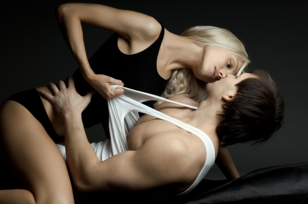 muscular handsome sexy guy with pretty woman, on dark background, glamour  light Stock Photo - 14996142