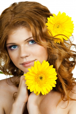 belle: the very  pretty red-haired blue eyed young woman  with yellow flower,  smile , vertical close up portrait