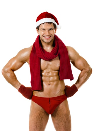 the very muscular  bronzed handsome sexy Santa Claus in red muffler on white  background, posture and smile, isolated Stock Photo - 15165372