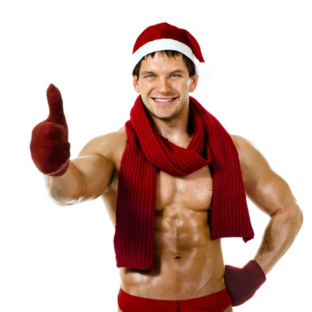 the very muscular  bronzed handsome sexy Santa Claus in red muffler on white  background, thumb up and smile, isolated Stock Photo - 15165288