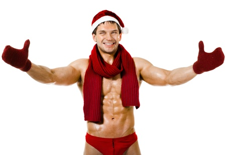 the very muscular  bronzed handsome sexy Santa Claus in red muffler on white  background, posture and smile, isolated Stock Photo - 15165315