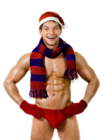 the very muscular  bronzed handsome sexy Santa Claus in red muffler on white  background, posture and smile, isolated Stock Photo - 15165466