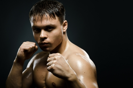 horizontal portrait  muscular young  guy street-fighter,  aggression look, hard light Stock Photo - 15165473