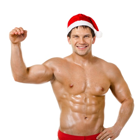 the very muscular  bronzed handsome sexy Santa Claus on white  background, posture and smile, isolated Stock Photo - 15165313