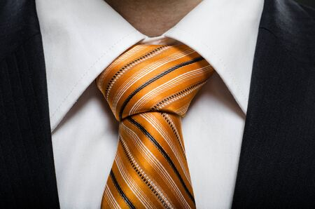 the beauty black business  costume with orange necktie, close up Stock Photo
