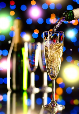 strew: bottle  champagne  stream and  splash in  glass goblet,  beautiful celebrations  concept photo