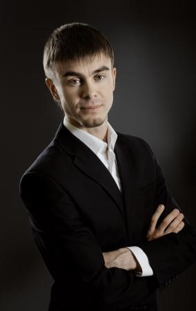 portrait  the  beautiful  businessman careerist in black costume without necktie Stock Photo - 15497220