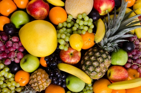 citrous: still life of big  heap multi-coloured fruits, horizontal  background
