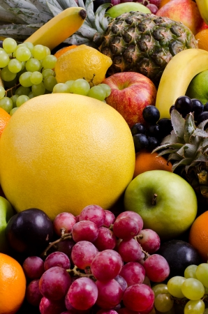 citrous: still life of big  heap multi-coloured fruits, vertical  background