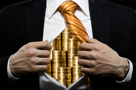 stealer: venality businessman or banker  in black costume throw open ones shirt packed heap gold money Stock Photo
