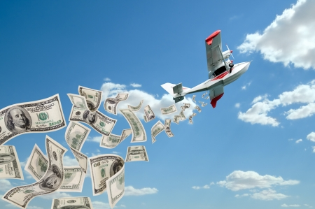 of  hydroplane flying in blue sky, rain down very mass dollar banknote photo