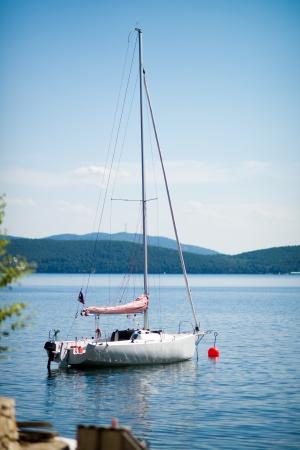 beautiful white sailing yacht , on beauty water landscape background, vertical photo Stock Photo - 15395964
