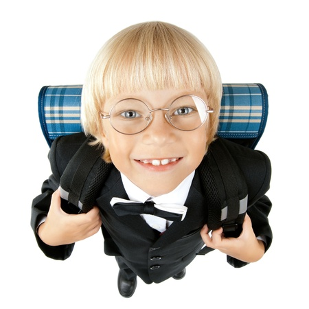 myopia: little children  schoolboy stare on camera through glasses and smile, on white background, isolated Stock Photo