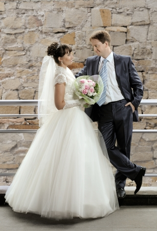 atilde: a happy newly married couple , romance embrace outdoor