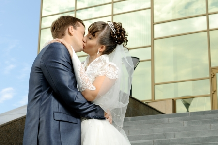 a happy newly married couple , romance embrace outdoor photo