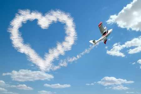hydroplane: twin-engine hydroplane flight in sky and draw white heart of  clouds