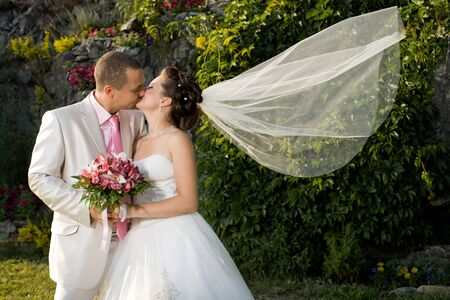 Happy newly married couple , romance embrace and kiss , outdoor photo