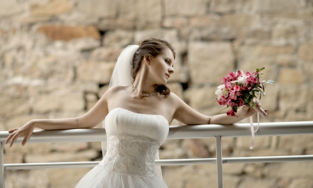 horizontal wedding portrait beautifull  fiancee with  bouquet  in white dress, soft light photo