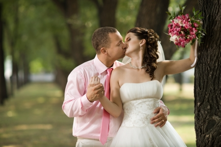 Happy newly married couple , romance embrace and kiss , outdoor Stock Photo - 15719078
