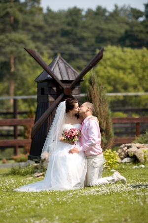 portrait happy newly married couple , romance embrace and kiss , outdoor photo