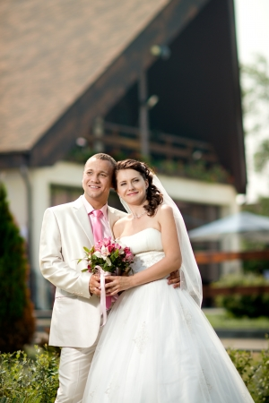 bridal couple: vertical portrait happy newly married couple , romance embrace outdoor Stock Photo