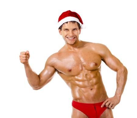 male nude: il molto muscoloso bronzato bello sexy Babbo Natale su sfondo bianco, la postura e sorriso, isolato