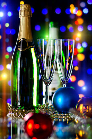 festively: bottle  champagne with two glass goblet,  beautiful celebrations  New Year concept photo Stock Photo