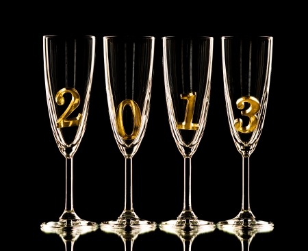 four glass goblet for champagne with  numeral 2013 on  black background,    New Year concept photo Stock Photo