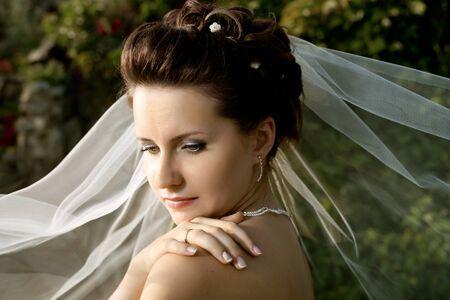 fiancee: horizontal wedding portrait beautiful  fiancee in white dress with wedding veil, on nature