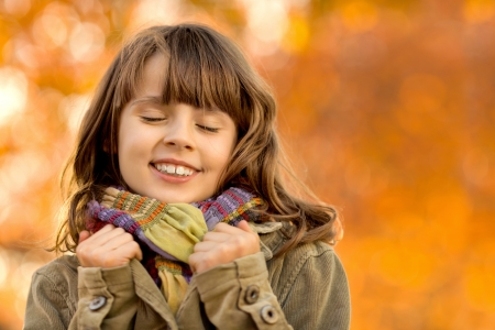 horizontal photo, happy beautiful little girl , autumnal portrait photo