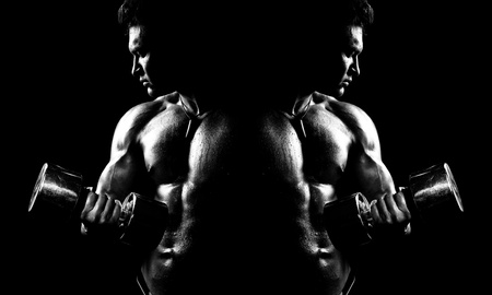very power athletic guy ,  execute exercise with  dumbbells, on bkack background, black-and-white Stock Photo - 16085566