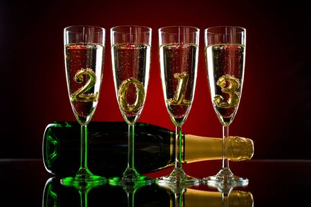 bottle  champagne with four glass goblet and  numeral 2013,  beautiful celebrations  New Year concept photo Stock Photo - 16151567
