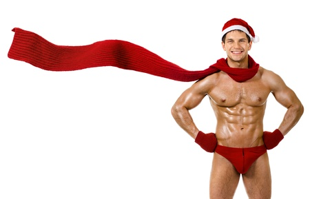 the very muscular  bronzed handsome sexy Santa Claus in red muffler on white  background, posture and smile, isolated Stock Photo - 16085541
