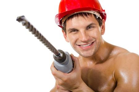 man close up: il lavoratore uomo bellezza perforatrice da vicino, maneggiare con perforatore, su sfondo bianco, isolato