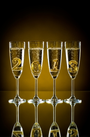 four glass goblet with champagne and  numeral 2013,  beautiful celebrations  New Year concept photo Stock Photo