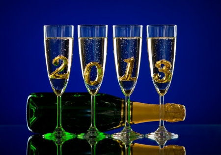 bottle  champagne with four glass goblet and  numeral 2013,  beautiful celebrations  New Year concept photo Stock Photo - 16261183